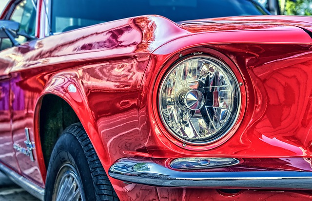 the headlights of a red car